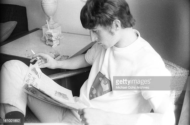 Peter Quaife of the rock group 'The Kinks' relax in their hotel room in August 1965 in New York New York