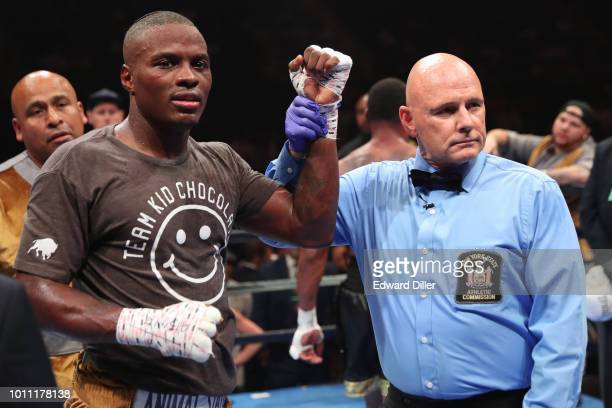 Peter Quillin celebrates with referee Danny Schiavone after defeating JLeon Love by unanimous decision at the Nassau Veterans Memorial Coliseum on...