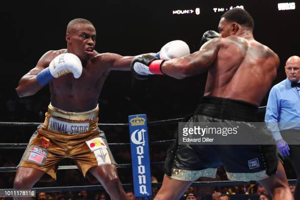 Peter Quillin lands a left hand against JLeon Love Quillin would win by unanimous decision at the Nassau Veterans Memorial Coliseum on August 4 2018...
