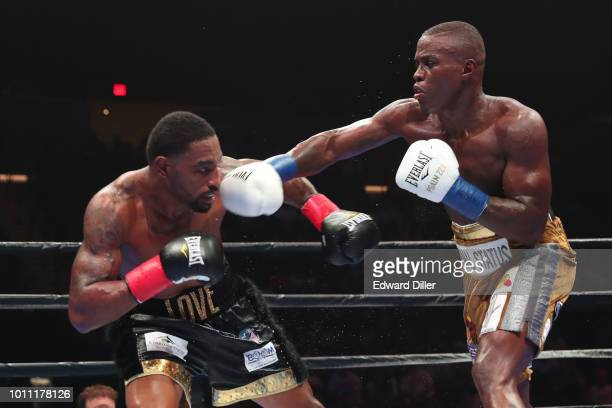 Peter Quillin throws a right hand against JLeon Love Quillin would win by unanimous decision at the Nassau Veterans Memorial Coliseum on August 4...