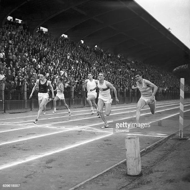 Peter Radford David Robbie Brightwell Armin Hary and Jocelyn Delecour at the finish of a men's 100meter race at Stade JeanBouin