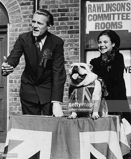 Peter Rawlinson Conservative Party candidate for Hackney speaking at an outdoor committee event with the bulldog 'Churchill' and his owner Mary...