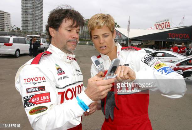 Peter Reckell and Dara Torres during 2004 Toyota Long Beach Grand Prix Pro/Celebrity Race Press Day at LB Grand Prix Pit Lane in Long Beach...