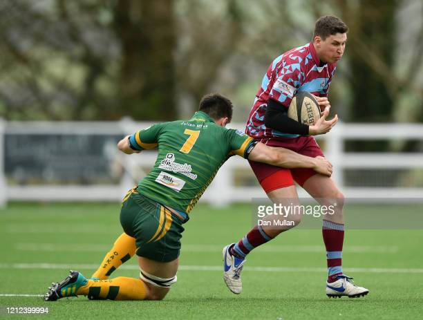 Peter Regan of OPMs is tackled by Sam Snell of Plymstock Albion Oaks during the Lockie Cup Semi Final match between Old Plymouthian and Mannameadians...