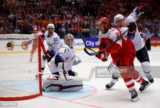 Peter Regin of Denmark and Connor Murphy of United States battle for the puck during the 2018 IIHF Ice Hockey World Championship group stage game...