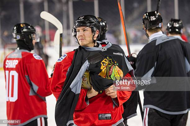 Peter Regin of the Chicago Blackhawks looks on during the 2014 NHL Stadium Series practice day on February 28, 2014 at Soldier Field in Chicago,...