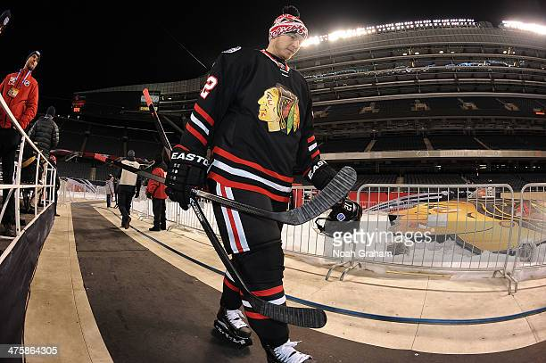 Peter Regin of the Chicago Blackhawks makes his way to the ice surface for the 2014 NHL Stadium Series practice day at Soldier Field on February 28,...