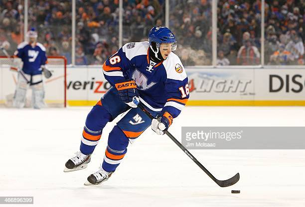 Peter Regin of the New York Islanders in action against the New York Rangers during the 2014 Coors Light NHL Stadium Series at Yankee Stadium on...