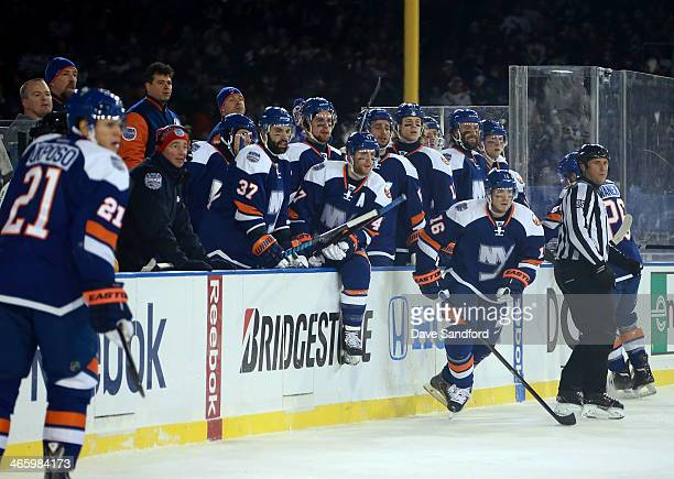 Peter Regin of the New York Islanders jumps on the ice for a line change during the 2014 Coors Light NHL Stadium Series at Yankee Stadium on January...