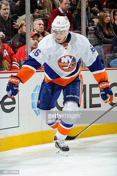 Peter Regin of the New York Islanders reaches across the ice during the NHL game against the Chicago Blackhawks on October 11, 2013 at the United...