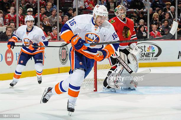 Peter Regin of the New York Islanders skates against the Chicago Blackhawks during the NHL game on October 11, 2013 at the United Center in Chicago,...