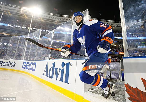 Peter Regin of the New York Islanders takes the ice to play against the New York Rangers during the 2014 Coors Light NHL Stadium Series at Yankee...