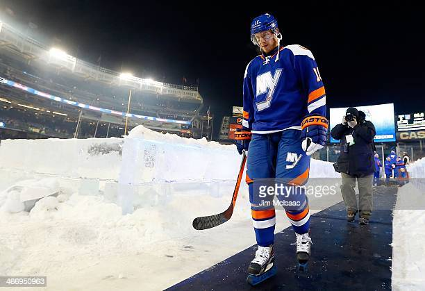 Peter Regin of the New York Islanders walks of the ice after the 2014 Coors Light NHL Stadium Series game against the New York Rangers at Yankee...