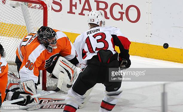 Peter Regin of the Ottawa Senators skates after an airborne puck in front of goalie Ilya Bryzgalov of the Philadelphia Flyers on March 2, 2013 at the...