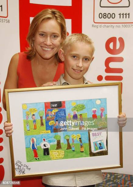 Peter Reid from Buckie Moray with BBC TV news presenter Sophie Raworth and his award winning cartoon which he entered in the Childline Cartoon Crazy...