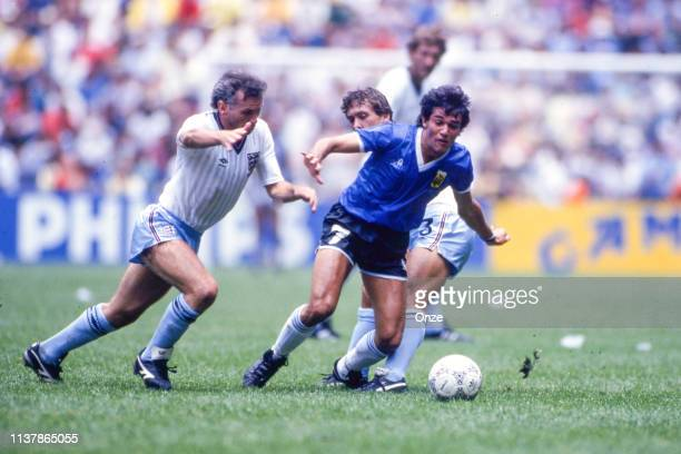 Peter Reid of England Jorge Burruchaga of Argentina and Kenny Sansom of England during the World Cup Quarter Final match between Argentina and...