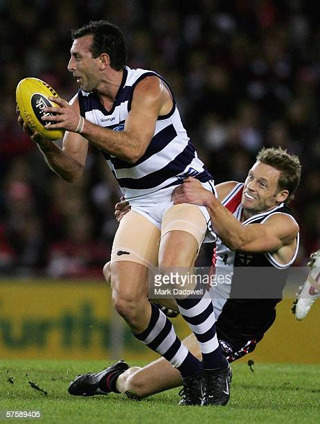 Peter Riccardi of the Cats is tackled by Andrew Thompson of the Saints during the round seven AFL match between the St Kilda Saints and the Geelong...
