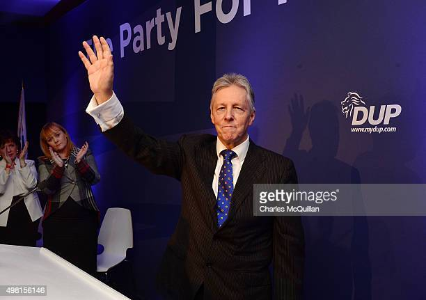 Peter Robinson waves goodbye to the party faithful after his final leaders speech during the Democratic Unionist Party annual conference at La Mon...