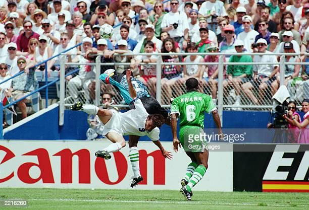 Peter Rufai of Nigeria comes out of his goal to clear the ball from Antonio Benarrivo of Italy during the FIFA World Cup Finals 1994 Second Round...
