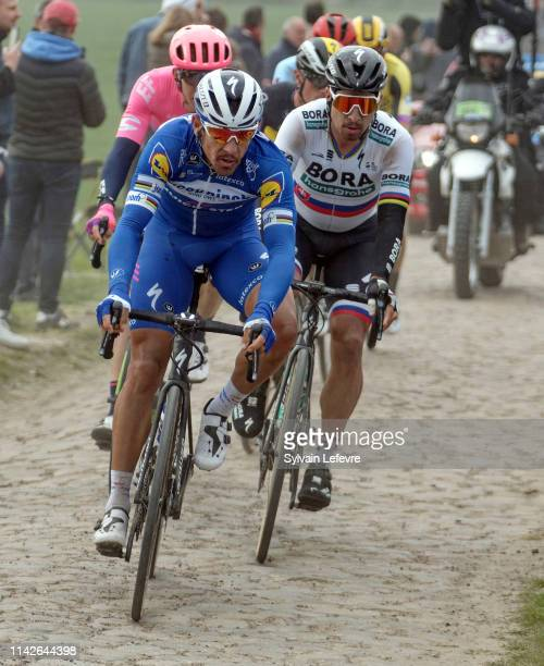 Peter Sagan and Philippe Gilbert ride the cobblestones sector 9 of Pont Thibaut in Ennevelin during the 117th Paris - Roubaix 2019 race from...