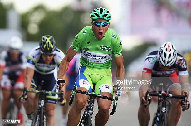 Peter Sagan of Slovakia and Liquigas-Cannondale celebrates as he crosses thefinish line to win stage six of the 2012 Tour de France from Epernay to...