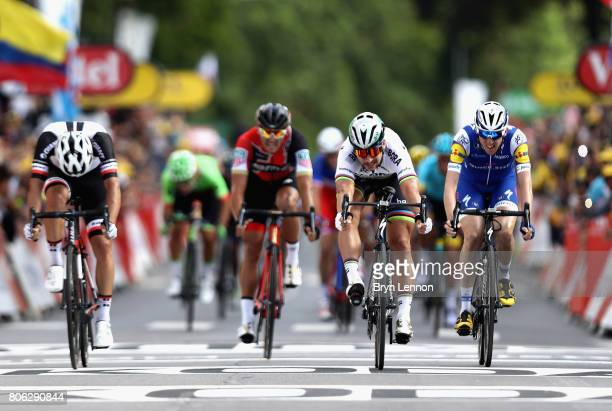 Peter Sagan of Slovakia and team Bora-Hansgrohe celebrates as he crosses the line to win stage 3 of the 2017 Tour de France, a 212.5km road stage...