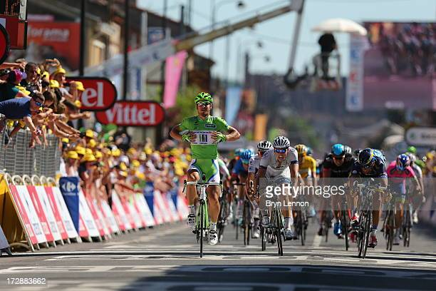 Peter Sagan of Slovakia and Team Cannondale celebrates as he crosses the finish line to win stage seven of the 2013 Tour de France, a 205.5KM road...