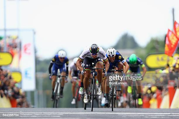 Peter Sagan of Slovakia and the Tinkoff team crosses the line to win stage two of the 2016 Tour de France from SaintLo to CherbourgOcteville on July...