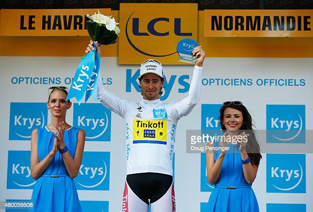 Peter Sagan of Slovakia and Tinkoff-Saxo celebrates as he is awarded the white jersey on the podium after stage six of the 2015 Tour de France, a...