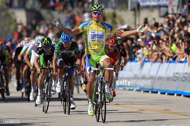 Peter Sagan of Slovakia celebrates as he crosses the finish line to win stage two ahead of Heinrich Haussler of Australia riding for Garmin-Barracuda...