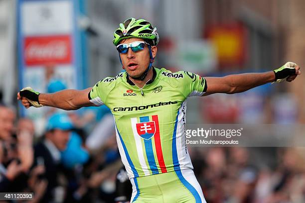 Peter Sagan of Slovakia celebrates as he crosses the finish line to win the E3 Harelbeke Cycle Race on March 28, 2014 in Harelbeke, Belgium.