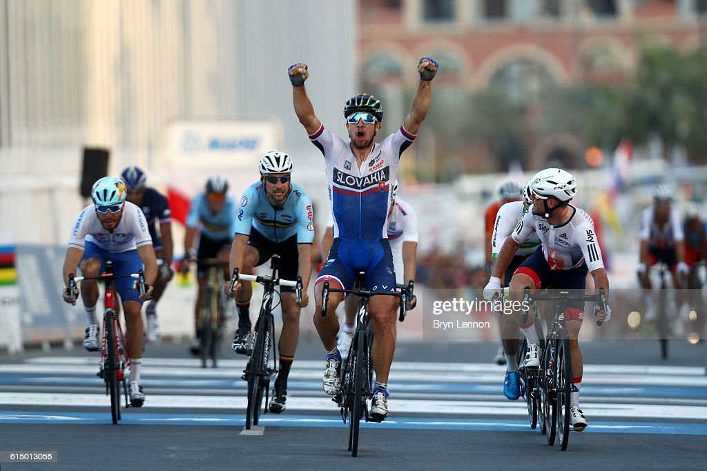 Peter Sagan of Slovakia celebrates victory as he crosses the finish line next to Mark Cavendish of Great Britain during the Elite Men's Road Race on day eight of the UCI Road World Championships on October 16, 2016 in Doha, Qatar.