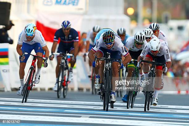 Peter Sagan of Slovakia leads Mark Cavendish of Great Britain as they approach the finish line of the Elite Men's Road Race on day eight of the UCI...
