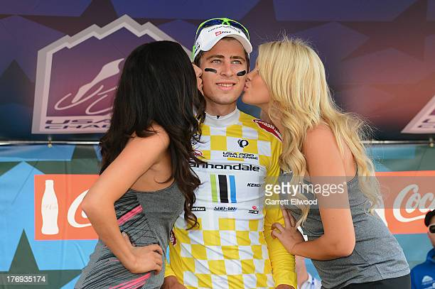 Peter Sagan of Slovakia riding for Cannondale Pro Cycling receives kisses from the podium girls after winning Stage One of the USA Pro Cycling...