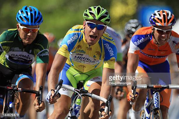 Peter Sagan of Slovakia riding for Liquigas-Cannondale begins to celebrate as he crosses the finish line ahead of Heinrich Haussler of Australia...