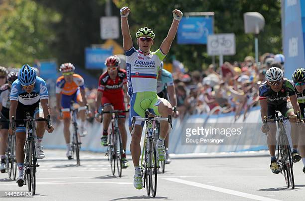 Peter Sagan of Slovakia riding for Liquigas-Cannondale celebrate his victory as Heinrich Haussler of Australia riding for Garmin - Barracuda finishes...