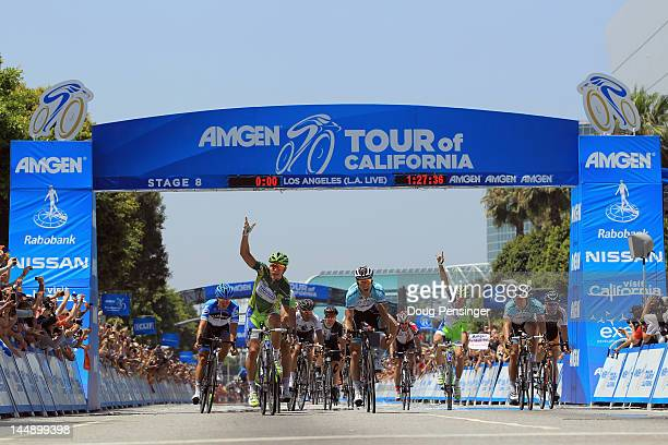 Peter Sagan of Slovakia riding for LiquigasCannondale celebrates his fifth stage victory as he defends the overall points leader green jersey with a...