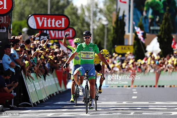 Peter Sagan of Slovakia riding for Tinkoff in the green sprinters jersey takes the stage win from Chris Froome of Great Britain riding for Team Sky...