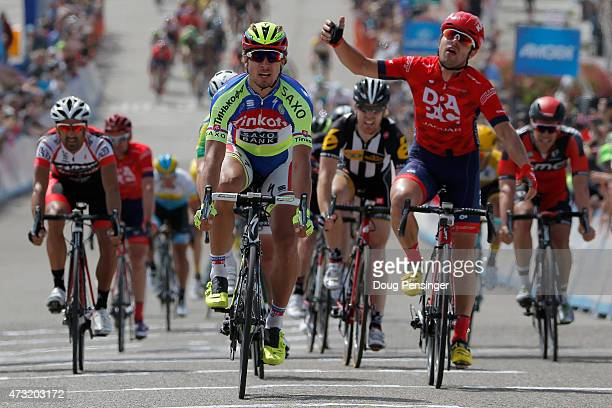 Peter Sagan of Slovakia riding for TinkoffSaxo celebrates his win and Wouter Wippert of the Netherlands riding for Drapac Professional Cycling reacts...