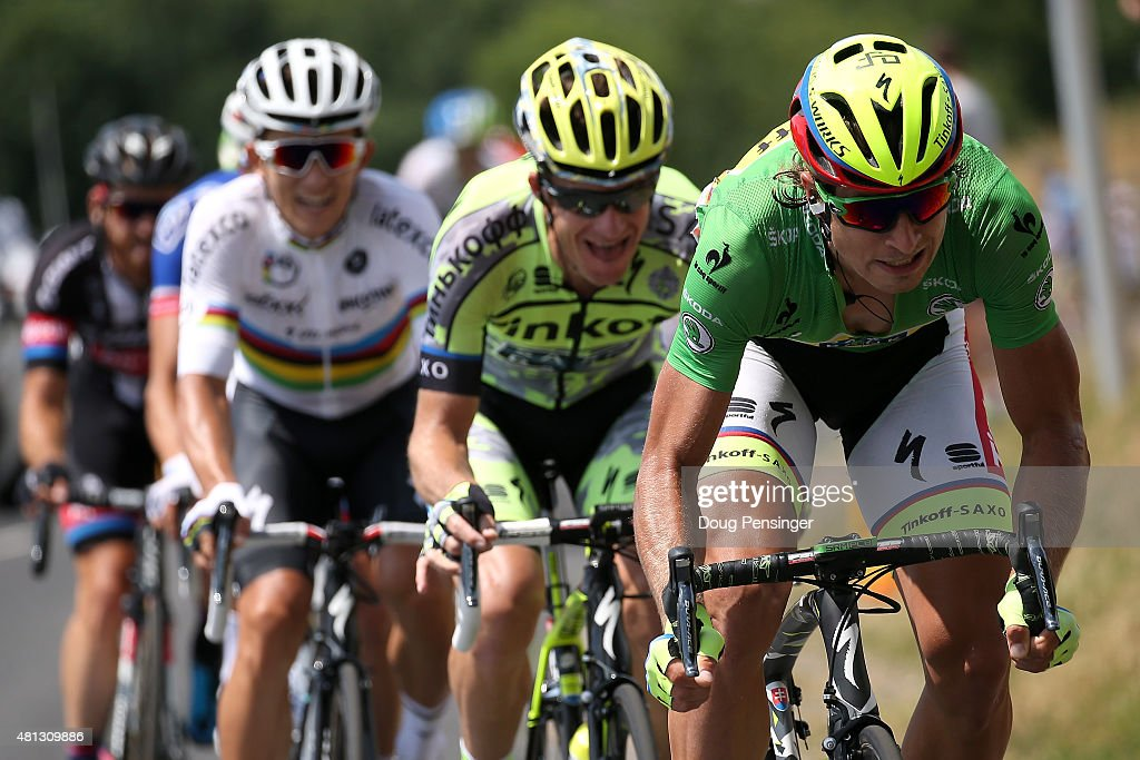 Peter Sagan of Slovakia riding for Tinkoff-Saxo in the green points leader jersey puts pressure on at the front of the breakaway as he is followed by teammate Michael Rogers of Australia riding for Tinkoff-Saxo and World Champion Michal Kwiatkowski of Poland riding for Etixx-QuickStep during stage 15 of the 2015 Tour de France from Mende to Valence on July 19, 2015 in Mirandol, France.