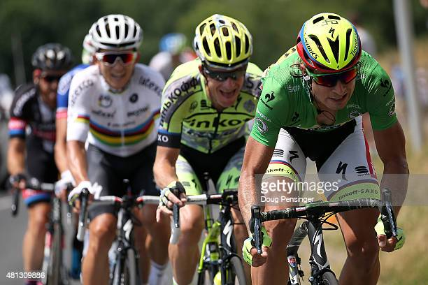 Peter Sagan of Slovakia riding for TinkoffSaxo in the green points leader jersey puts pressure on at the front of the breakaway as he is followed by...