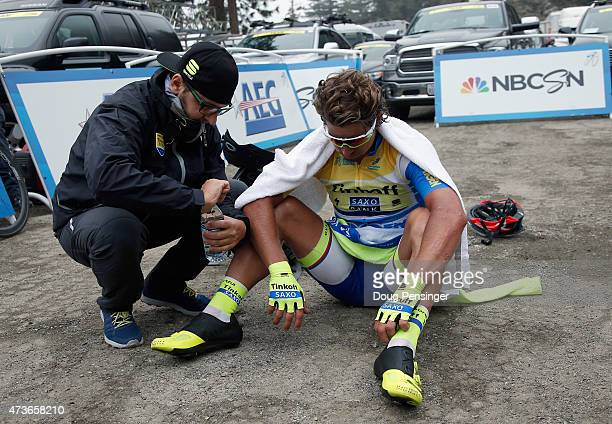 Peter Sagan of Slovakia riding for Tinkoff-Saxo is attended to by his soigneur after the finish as he lost the overall race leader yellow jersey to...