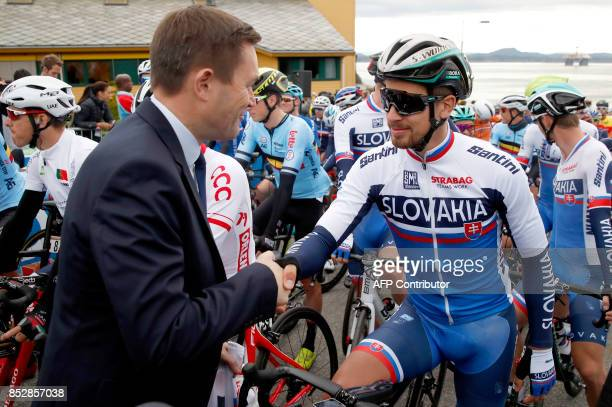 Peter Sagan of Slovakia shakes hands with UCI president David Lappartient before start of Men Elite Road Race at the UCI 2017 Road World Championship...