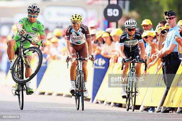 Peter Sagan of Solvakia and Cannondale 'wheelies' over the finishline on the fourteenth stage of the 2014 Tour de France a 177km stage between...