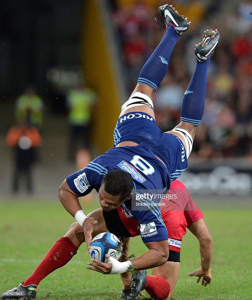 Peter Saili of the Blues is up-ended in a tackle during the round 11 Super Rugby match between the Reds and the Blues at Suncorp Stadium on April 26, 2013 in Brisbane, Australia.