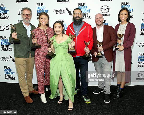 Peter Saraf Daniele Tate Melia Lulu Wang Andrew Miano a guest and Anita Gou winners of Best Feature for The Farewell pose in the press room during...