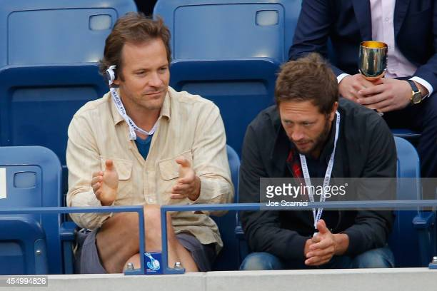 Peter Sarsgaard and Ebon Moss-Bachrach attend the Moet & Chandon Suite at the 2014 US Open Men's Final at USTA Billie Jean King National Tennis...