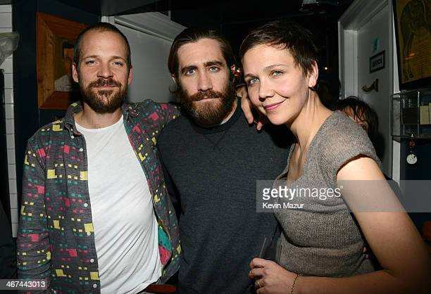 Peter Sarsgaard Jake Gyllenhaal and Maggie Gyllenhaal attends Pussy Riot and The Voice Project party at The Spotted Pig on February 6 2014 in New...