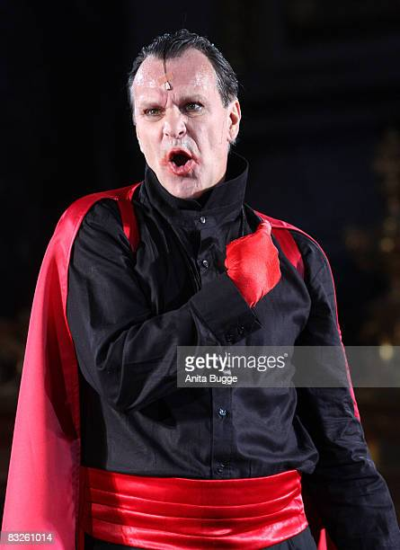 "Peter Sattmann as the devil performs during the dress rehearsal for the play ""Jedermann"" by author Hugo von Hoffmannsthal at the Berlin Cathedral on..."