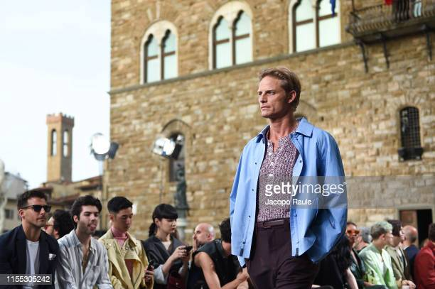 Peter Saville walks the runway at the Salvatore Ferragamo fashion show in Piazza della Signoria during Pitti Immagine Uomo 96 on June 11, 2019 in...